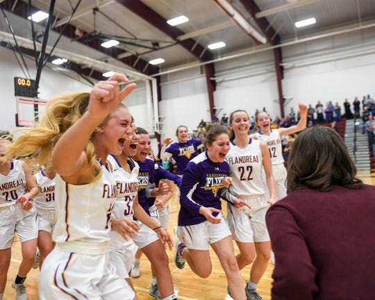 Flandreau celebrates a win against West Central during the SoDak 16 on Monday, March 9, 2020 at Madison High School. The final score of the game was 60-55.