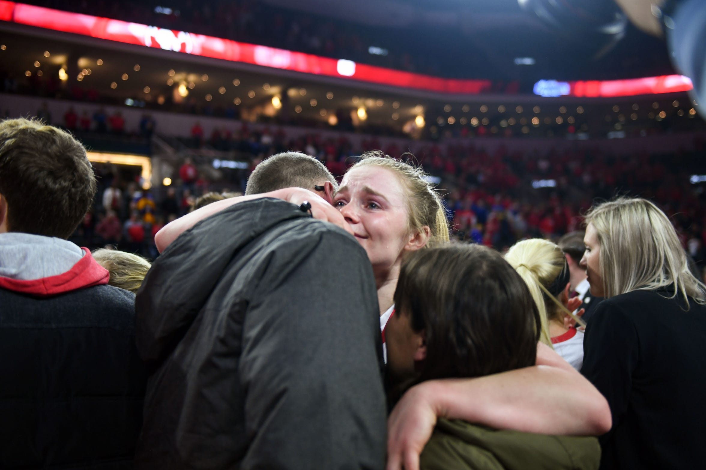 USD's Monica Arens smiles through tears as she hugs her parents after the team's Summit League championship win on Tuesday, March 10, at the Denny Sanford Premier Center in Sioux Falls.