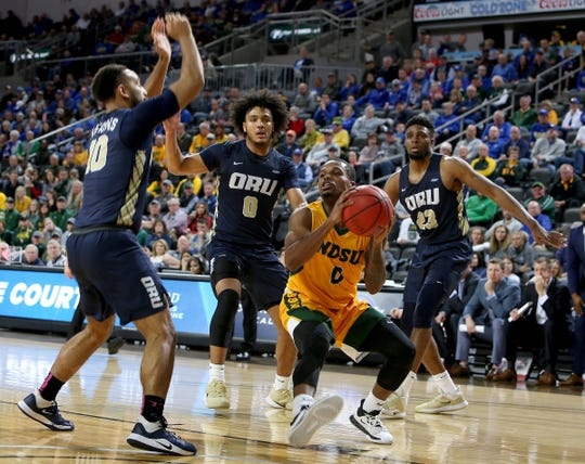 SIOUX FALLS, SD - MARCH 8: Vinnie Shahid #0 of the North Dakota State Bison looks for help whole being surrounded by the Oral Roberts Golden Eagles defense at the 2020 Summit League Basketball Championship in Sioux Falls, SD. (Photo by Dave Eggen/Inertia)