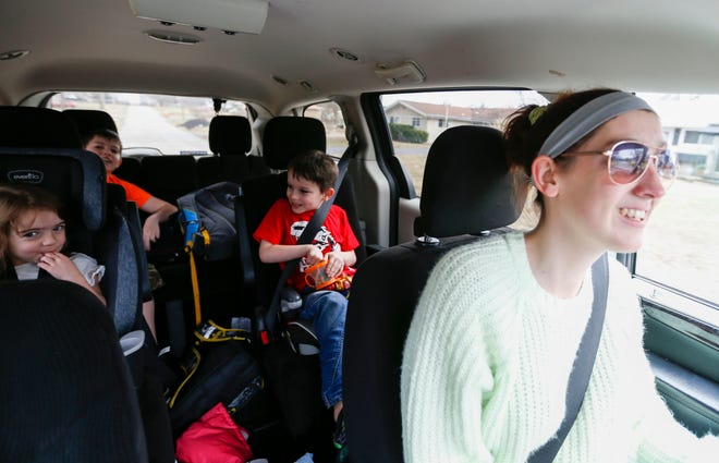 Cheyenne Mauzy-Wicken drives her children Amara, Landon and Mason home after picking them up from day care and school on Monday, March 2, 2020.