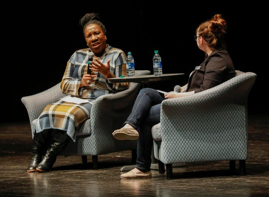 """Civil rights activist and founder of the """"Me Too"""" movement Tarana Burke, left, speaks during an event at Juanita K. Hammons Hall on Tuesday, March 10, 2020."""
