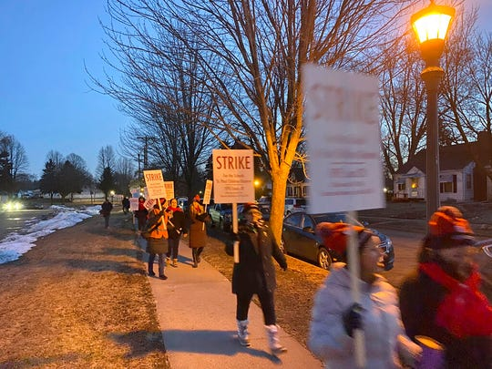 St. Paul teachers march during a strike early Tuesday, March 10, 2020, in St. Paul. Teachers at St. Paul Public Schools went on strike Tuesday after last-minute efforts to reach a contract agreement failed.