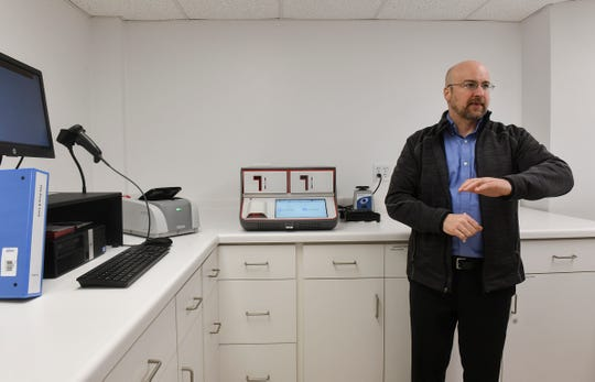 Vice President of Research and Development Brian Beck talks about equipment used for testing for different types of viruses Tuesday, March 10, 2020, at Microbiologics in St. Cloud.