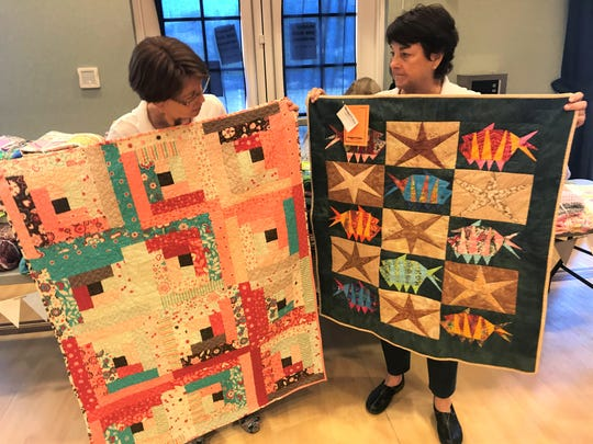 Project Linus members Karen Goforth (left) and Lana Stewart display two blankets that will go to kids in need.