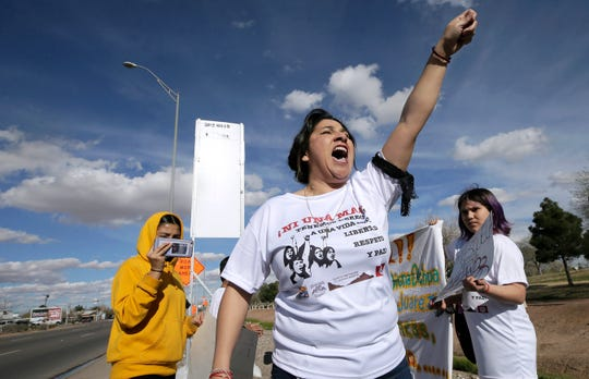 Hilda Villegas of Familias Unidas del Chamizal chants as she leads a march Monday in El Paso in solidarity with women across Mexico who are marching to end violence against women.