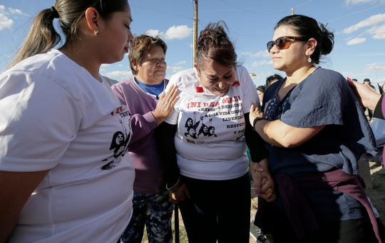 Veronica Macias is comforted at the Women's March in El Paso after she talked about the murder of her youngest sister in Juárez. The march was held in solidarity with women across Mexico marching against femicide.