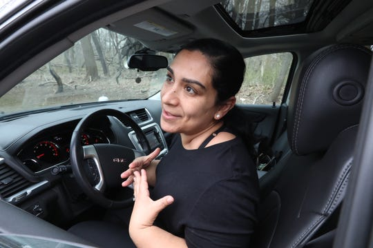 Karla Valencia waits to pick up her son at the William Ward School in New Rochelle March 10, 2020.
