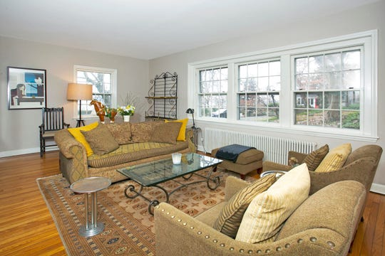 The home has two bedrooms and access, across the street, to a beach on the Hudson River.