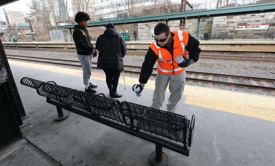Giovanni Argentari, a custodian with Metro-North Railroad, disinfects public areas at the New Rochelle Metro-North train station, March 10, 2020.