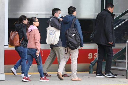 Commuters from New York arrive at the New Rochelle Metro-North train station, March 10, 2020.