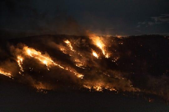 People watch Breakneck Ridge burn from Plum Point  in New Windsor on March 9, 2020.