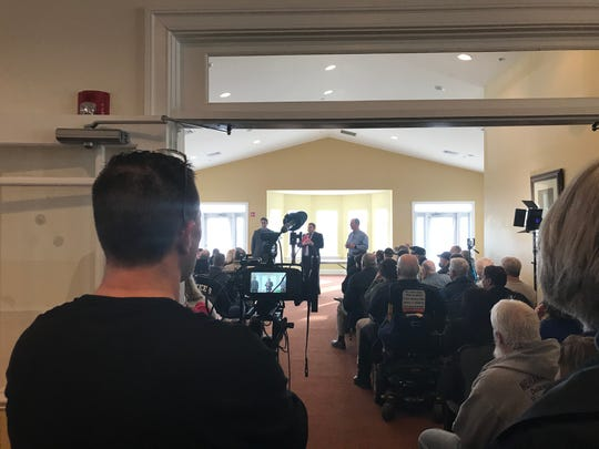 Local leaders being filmed during their discussion of a Muslim cemetery in Port Penn.