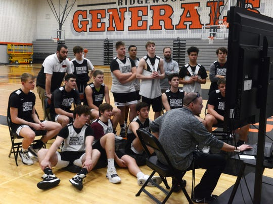 Ridgewood boys basketball coach Troy Dolick talks to the team during a film session during practice on Monday at the high school. The Generals will play in the school's first regional tournament in Athens.