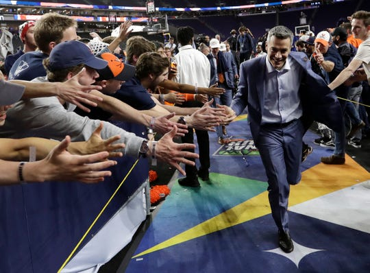 Virginia head coach Tony Bennett celebrates with fans after the championship game against Texas Tech in Minneapolis in 2019.