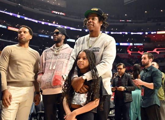 Recording artists 2 Chainz (left) and Jay Z with daughter Blue Ivy Carter attend the NBA game between the LA Clippers and the Los Angeles Lakers at the Staples Center.