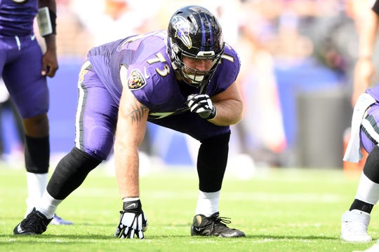 Baltimore Ravens offensive guard Marshal Yanda (73) looks on during a football game against the Cleveland Browns in the second quarter at M&T Bank Stadium.