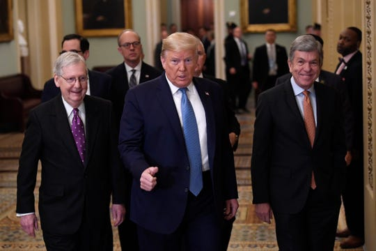 President Donald Trump, center, walks with Senate Majority Leader Mitch McConnell of Ky., left, and Sen. Roy Blunt, R-Mo., right, on Capitol Hill in Washington, Tuesday, March 10, 2020.