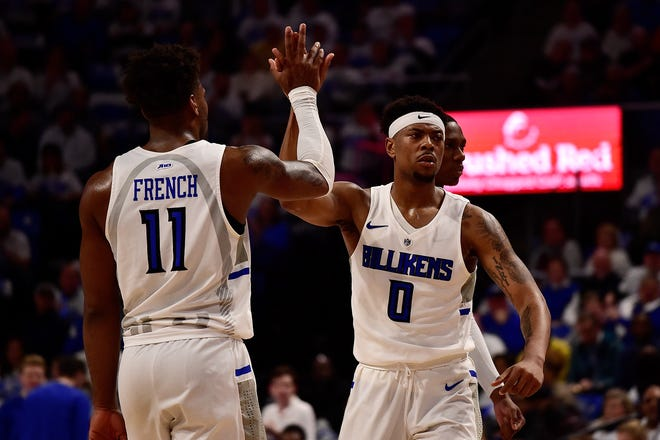 Saint Louis Billikens guard Jordan Goodwin (0) celebrate with forward Hasahn French (11) during the first half against the Dayton Flyers at Chaifetz Arena.