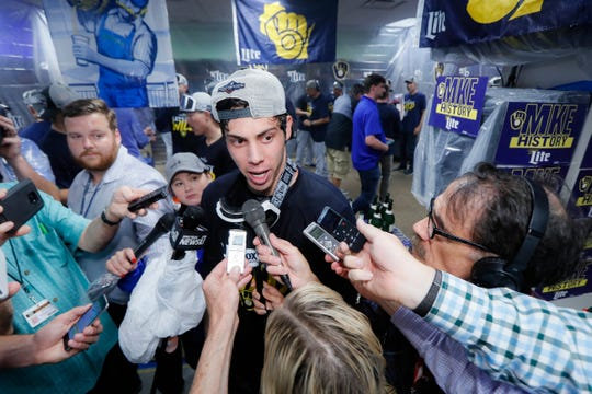 Brewers outfielder Christian Yelich speaking to reporters in the team's clubhouse in 2019.