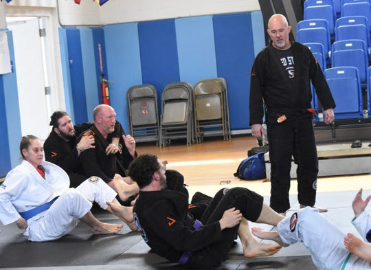 Clint DuPlechian (right), owner of Alexandria Gracie United Brazilian Jiu Jitsu and Karate Kicks, was recently promoted to black belt and earned the title of professor. He is the only Brazilian Jiu Jitsu black belt in Central Louisiana.