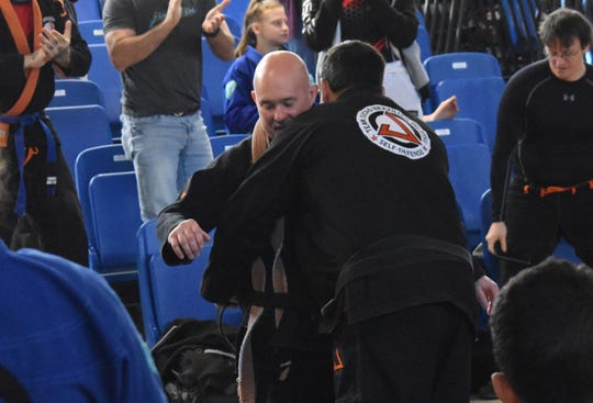Professor Raefel Ellwanger, a fourth degree black belt in Brazilian Jiu Jitsu, promoted Clint DuPlechian, owner of Alexandria Gracie United Brazilian Jiu Jitsu and Karate Kicks, to a black belt. He also earned the title of professor. DuPlechian is the only Brazilian Jiu Jitsu black belt in Central Louisiana.