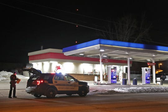 Appleton police respond to the Newberry Station after accused killer Demetrius L. Williams called 911 to report he went on a stabbing rage at a nearby apartment.
