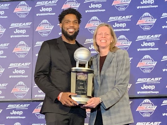 Myles Powell accepts the Player of the Year trophy from Big East commissioner Val Ackerman.