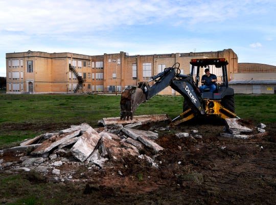 Concrete is dug out and piled behind the former Lincoln Middle School on Wednesday. The building and surrounding property is being renovated into Abilene Heritage Square, a multipurpose facility that will feature a public library and and extension of The Grace Museum.