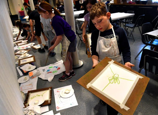 Ethan Farr, 9, places an art project to the side with the others he and his classmates made Wednesday at The Grace Museum's Spring Break Art Camp. The camp concludes Thursday, to be followed from 5:30-8 p.m. with International Infusion Family Night in the museum's courtyard.