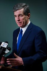 North Carolina governor Roy Cooper speaks to media about coronavirus after a closed meeting with local officials at AB Tech in Asheville March 10, 2020.