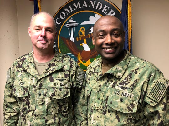 """Rear Adm. Christopher """"Scotty"""" Gray, left, is leaving the Pacific Northwest following two years as head of the Navy's installations. Rear Adm. Stephen D. Barnett, right, is taking Gray's place."""