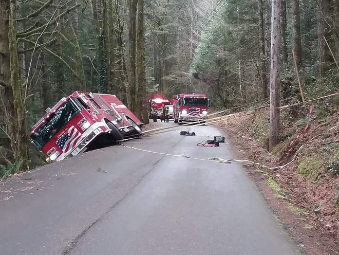 A South Kitsap fire engine rests nearly on its side on a road west of Gorst Wednesday.