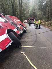 A South Kitsap fire engine rests nearly on its side on a road west of Gorst on March 11, 2020. The driver hugged the right side of the road to give cleance to a passing vehicle and the roadside crumbled.
