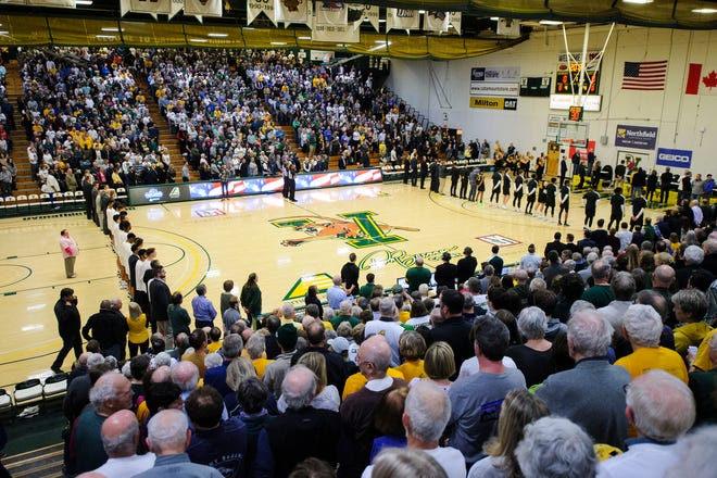 The teams listen to the National Anthem during the America East men's basketball semifinal game between the UMBC Retrievers and the Vermont Catamounts at Patrick Gym on Tuesday night March 10, 2020 in Burlington, Vermont.