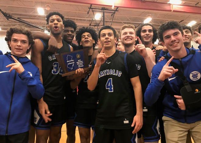 The Wildwood Catholic boys basketball team celebrates its Non-Public B South championship on Wednesday night.