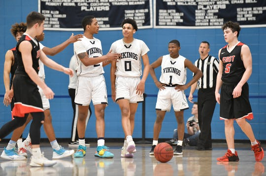 Left to right, Atlantic City's Stephen Byard, Teriq Chapman and Naquan Blakeley, on the court during the South Jersey Group 4 boys basketball final against Cherry Hill East. The Vikings topped the Cougars, 61-44, on Tuesday, March 10, 2020.