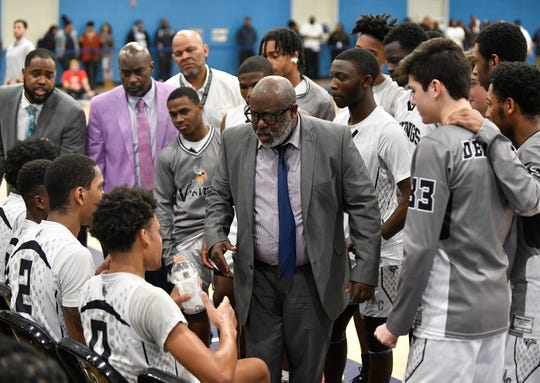 Atlantic City boys basketball coach Gene Allen congratulates his players during the South Jersey Group 4 boys basketball final against Cherry Hill East. The Vikings topped the Cougars, 61-44, on Tuesday, March 10, 2020.