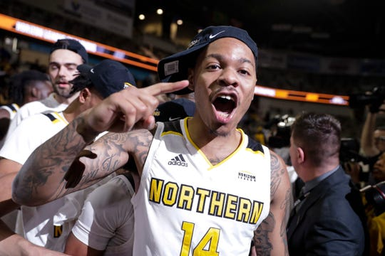 Northern Kentucky guard Karl Harris (14) celebrates following an NCAA college basketball game against Illinois Chicago for the Horizon League men's tournament championship in Indianapolis, Tuesday, March 10, 2020. Northern Kentucky defeated Illinois Chicago 71-62.