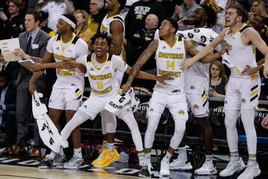 Northern Kentucky's Tre Cobbs, Jalen Tate, Karl Harris (14) and Bryant Mocaby (30), from left, celebrate on the bench during the second half against Illinois-Chicago in an NCAA college basketball game for the Horizon League men's tournament championship in Indianapolis, Tuesday, March 10, 2020. Northern Kentucky won 71-62.