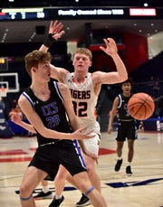 Kai Vance (20) dishes off the rock under the hoop to an open Cincinnati Christian teammate at the OHSAA Division IV regional semifinal March 10, 2020.
