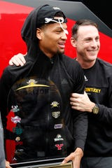 Head coach Darrin Horn hugs senior Dantez Walton outside the student union building at Northern Kentucky University in Highland Heights, Ky., on Wednesday, March 11, 2020. Fan celebrated the return to campus of the men's basketball team following its Tuesday night Horizon League Tournament Championship win in Indianapolis. The Norse now advance to their Div-1 NCAA Tournament berth.
