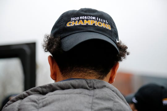 Players wear celebratory championship hats outside the student union building at Northern Kentucky University in Highland Heights, Ky., on Wednesday, March 11, 2020.
