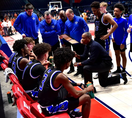 Coach Carl Woods resets the Cincinnati Christian defense late in the game at the OHSAA Division IV regional semifinal March 10, 2020.