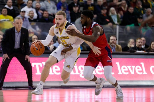 Northern Kentucky guard Tyler Sharpe (15) drives on Illinois-Chicago guard Marcus Ottey during the first half of an NCAA college basketball game for the Horizon League men's tournament championship in Indianapolis, Tuesday, March 10, 2020.