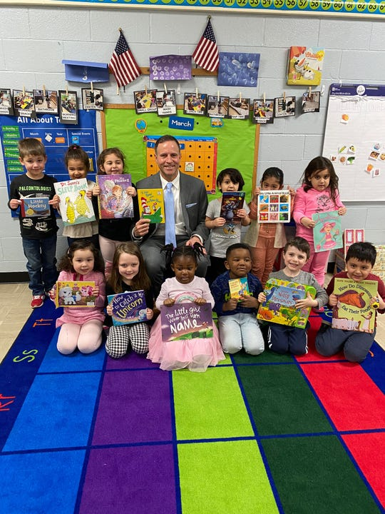 Greater Somerset County YMCA CEO David M. Carcieri reads Dr. Seuss to Early Education children during Read Across America Week.
