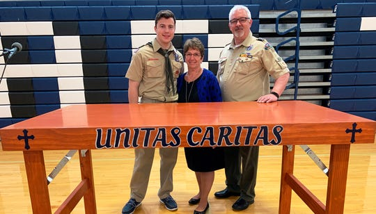 Shown here are Griffin Leger, Director of Campus Ministry Maureen Cote, and Assistant Scoutmaster for Troop 83 of Somerville John DuBose.