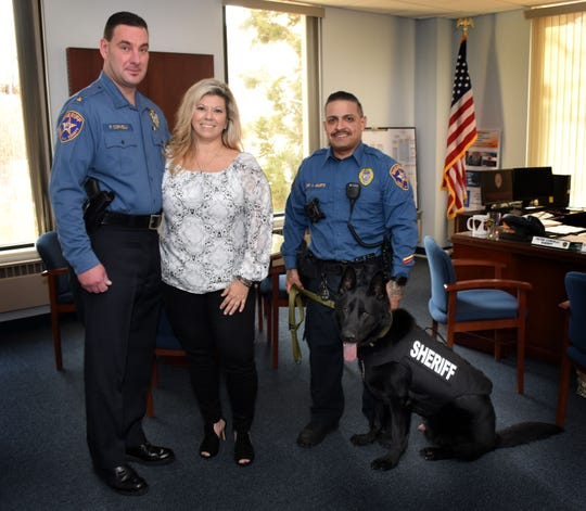 Union County Sheriff Peter Corvelli and Sheriff's Officer Nelson Agurto thank Dr. Julie Tropeano for sponsoring a bullet and stab protective vest for Union County Sheriff's Office K9 Ceasar.
