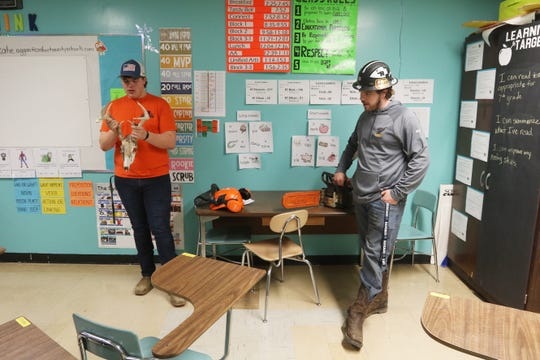 Austin Fowler, left, and Hayden Shook talk about some of the opportunities available to students in Coshocton County Career Center's natural resources program during Coshocton Middle School's career day.