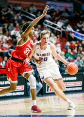 Waukee's Payton Sandfort drives to the basket as North Scott's Tytan Anderson defends during the 4A state basketball quarterfinal matchup at Wells Fargo Arena Tuesday, March 10, 2020.