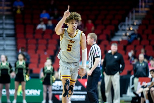 Ankeny's Braxton Bayless celebrates winning the Iowa City West vs. Ankeny boys' basketball state tournament Class 4A quarterfinal on Wednesday, March 11, 2020, at Wells Fargo Arena in Des Moines.